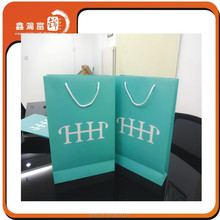 wholesale alibaba popular wavy shaped gift shopping paper bag