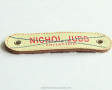 silk screen printing branded leather tags with metal eyelets