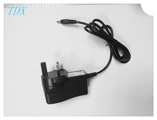 UK Plug 220v to 24v plug adapter current 300ma send a free sample