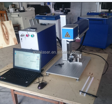 China laser marking and engraving machine for mobile phone cover/ear phone in China
