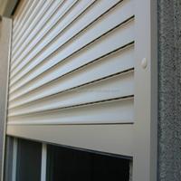 Insulated kitchen cabinet roller shutter