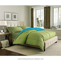 cotton polyester blend solid reversible comforter-green/light blue
