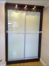 glass wardrobe design with mirror sliding door