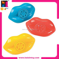 1088327 Party favor 2.5 inch lips shape cheap plastic toy whistle