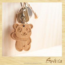 2015 Taiwan manufacture new design patent craft carving wooden panda car logo 3d leather pvc keychain