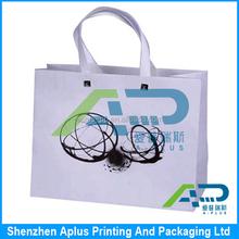 High quality 250 gsm white art paper gift bag with silk ribbon handle , white paper bag matt lamination