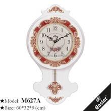 Glass pendulum quartz wall clock with swinging pendulum
