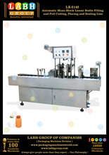 Automatic Bottle Filling and Aluminium Foil Sealing Packaging Machine