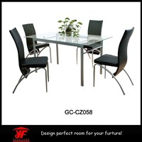 2015 Luxurious cheap modern glass dining table and chairs set