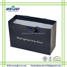 Black background,white text brand paper bags for suits