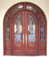 Main wood entry door with top transoms and sidelites
