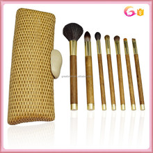 Gold aluminum ferrule professional 7pc wood handle makeup brush set with wicker clutch and stone closure