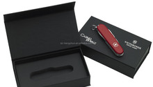 Black matte high end knife with silver logo and magnet clousure