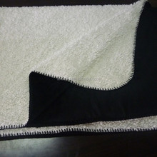 one side black and the other side white different fabric sewed sherpa fleece blanket