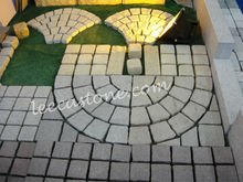 Grey tuff stone cobbles on mesh