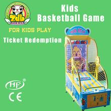 Kids shooting hoops arcade basketball game machine