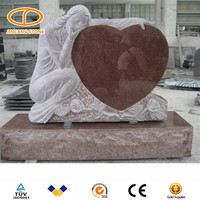 Heart shaped monuments headstone with angel wings engraving