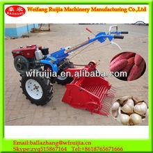 Best price single row mini sweet potato harvester , garlic harvester,potato harvester ,mini hand tractor with harvest machinery