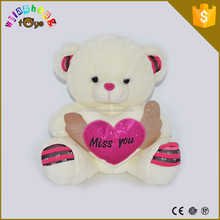High quality plush white cute bear with a the red rose heart Cheapest price qualified manufacturer pet toys