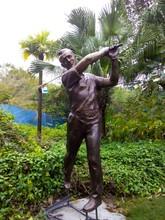 European style golf man with Nike belt bronze sculpture