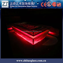 Flowery Media Player led red glass and brass coffee table