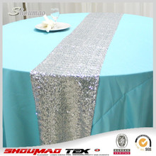 Modern silver sequin table runners for round tables