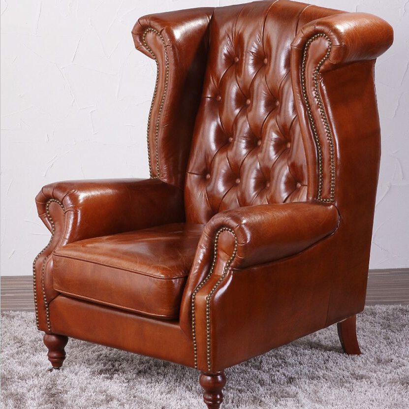 Deconstructed studded high back leather wing chair view for Leather studded couch