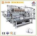 Maquinaria automática de fabricado de rollo de papel higiénico industrial.