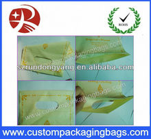 orange color plastic handle packing bags