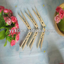 Various size wooden clothes pegs