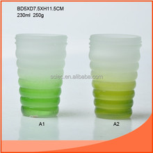 white and green glass ware for food or water