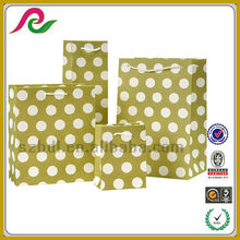 Yellow polka dot paper carrier gift shopping party bags with rope handle