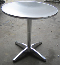 round brushed stainless steel table