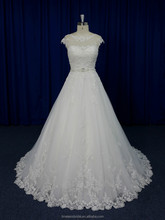 Breathtaking cap sleeves sheer top buttons back center glaring lace wedding dress