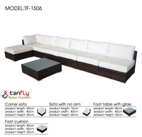 Outdoor wicker sectional sofa l shaped with all weather fabric cushions.