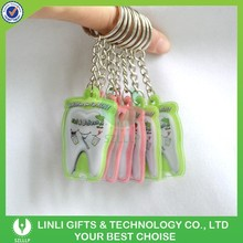 Cheap promotional led customised key ring tooth
