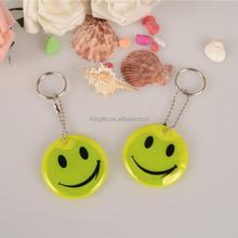 Wholesale smiling face souvenir reflective soft pvc keychain