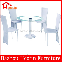 glass top dining table with PVC surface metal tube inside frame