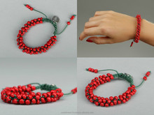 Red bracelet with beads handmade