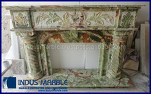 DARK GREEN ONYX FIREPLACE WITH CARVING WORK ROPE DESIGN WITH ARCH