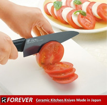 A kitchen knife with ceramic blade, with in Japan, very sharp, white, black and world's first striped color blades