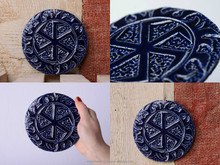 Plate amulet made of clay