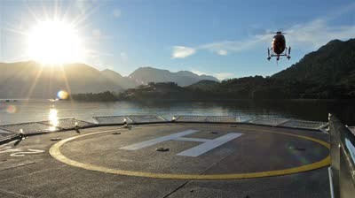 stock-footage-low-angle-of-a-helicopter-landing-on-a-ship-helipad-at-sunrise-near-chait-xed-xa-n-in-northern.jpg