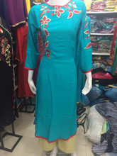 Flower neck and shoulder embroidery kurti in linen ..