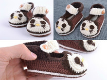 Magnificent baby shoes crocheted of brown and white cotton and woolen threads