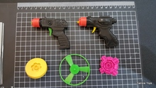 Spinning top toy gun 2 in 1 wholesale factory price